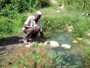 The Water Project:  Mr Shakava Removing Contaminants