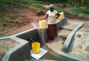 The Water Project : 23-kenya4725-mrs-grace-malezi-at-the-spring