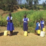 The Water Project : 3-kenya4741-students-waiting-in-line-at-the-spring