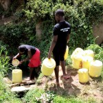 The Water Project: Kakubudu Community -  Fetching Water