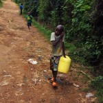 The Water Project: Bushevo Community -  Brian Weke Going To The Spring To Fetch Water