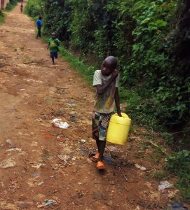 The Water Project:  Brian Weke Going To The Spring To Fetch Water