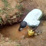 The Water Project: Lugango Community -  Andrew Fetching Water