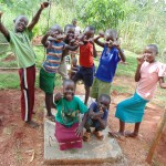 The Water Project : 34-kenya4719-precious-muyonga-leads-team-of-friends-to-show-thumbs-up-for-the-new-sanitation-platform