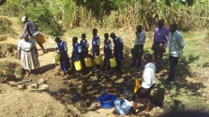 The Water Project : 4-kenya4741-community-members-and-students-waiting-in-line