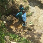 The Water Project: Futsi Fuvili Community, Patrick Munyalo Spring -  Fetching Water