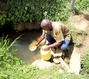 The Water Project:  Village Elder Fetching Water