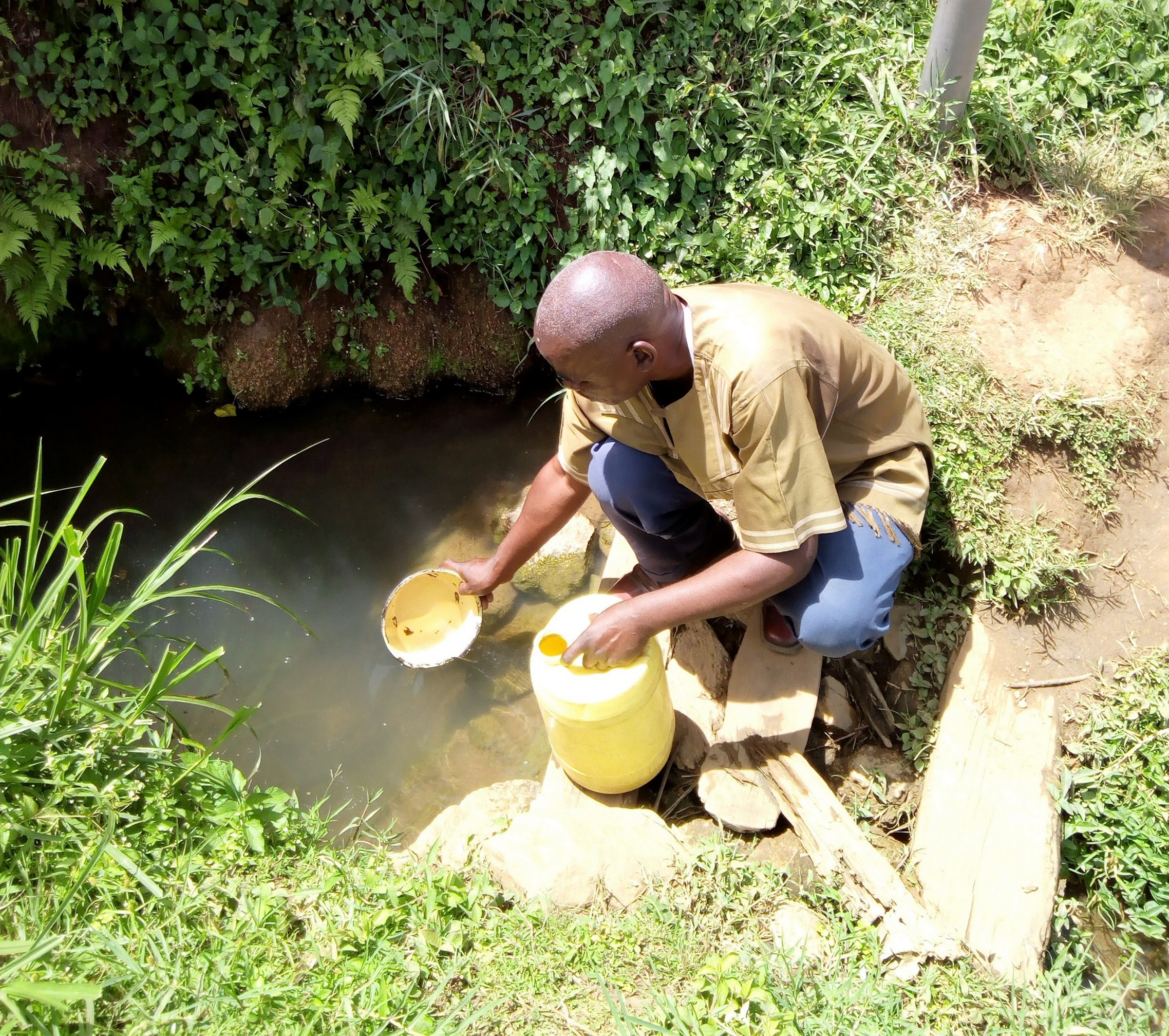 The Water Project : 4-kenya4749-village-elder-fetching-water