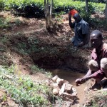 The Water Project: Mkunzulu Community -  Man Washing His Hands In Spring