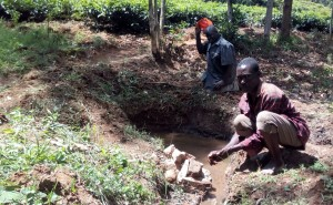 The Water Project : 4-kenya4750-man-washing-his-hands-in-spring