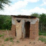 The Water Project: Kaani Community E -  Justina Pius Household Latrine