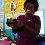 The Water Project: St. Antony Shijiko Primary School -  Headteacher Showing The Feeding Program Trophy