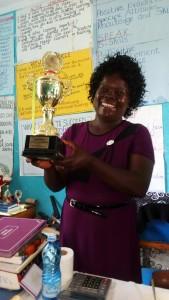 The Water Project : 4-kenya4836-headteacher-showing-the-feeding-program-trophy
