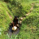 The Water Project: Bushevo Community -  Mrs Enani Fetching Water