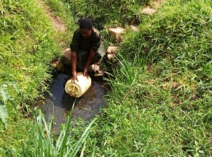 The Water Project:  Mrs Enani Fetching Water Cropped