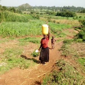 The Water Project : 4-kenya4847-going-home-with-dirty-water