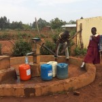 The Water Project: Shiyabo Secondary School -  Primary Students Wait For Community Member To Finish At Well