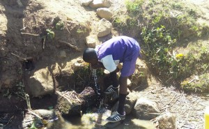 The Water Project : 5-kenya4741-student-drinking-spring-water
