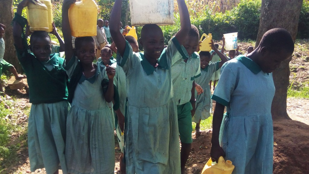 The Water Project : 5-kenya4830-carrying-heavy-water-containers-back-to-school