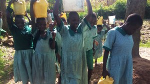 The Water Project:  Carrying Heavy Water Containers Back To School