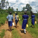 The Water Project: Namalenge Primary School -  Going To Fetch Water