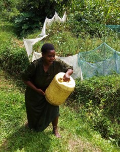 The Water Project:  Mrs Enani Lifts Liters Of Water