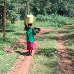 The Water Project: Mudete Community -  Carrying Water From The Spring