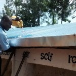 The Water Project: Ebukanga Primary School -  Demonstration On Gutter Cleaning