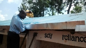 The Water Project:  Demonstration On Gutter Cleaning