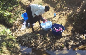 The Water Project : 6-kenya4741-alice-doing-laundry-at-the-spring