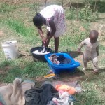 The Water Project: Shitoto Community, Laurence Spring -  Lady Does Laundry By Spring