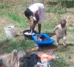 The Water Project:  Lady Does Laundry By Spring