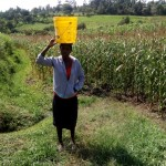 The Water Project: Shivagala Community, Paul Chengoli Spring -  Carrying Water
