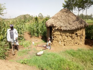 The Water Project:  Benjamin And His Wife Outside Their Home