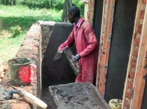 The Water Project : 7-kenya4663-artisan-working-on-latrines