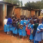 The Water Project: Mwiyenga Primary School -  Girls Line Up For Latrines During Break
