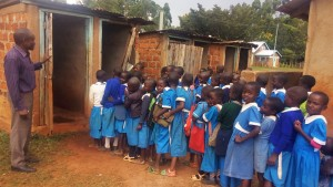 The Water Project:  Girls Line Up For Latrines During Break