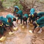 The Water Project: Buhunyilu Primary School -  Fetching Water