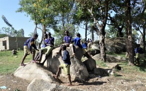 The Water Project:  Boys Relaxing On The Rocks Outside