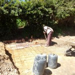 The Water Project: Chief Mutsembe Primary School -  Laying Latrine Foundation