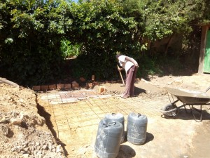 The Water Project:  Laying Latrine Foundation