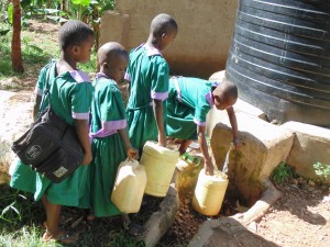 The Water Project:  Pupils In Line To Get Water From Plastic Tank