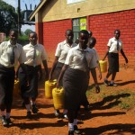 The Water Project: Evojo Secondary School -  Carrying Heavy Water