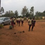 The Water Project: Shiyabo Secondary School -  Primary Students Walking Through Secondary Section