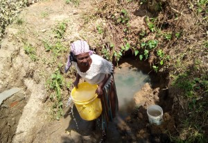 The Water Project:  Woman Fetching Water During Construction