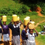 The Water Project: St. Antony Shijiko Primary School -  Carrying Water