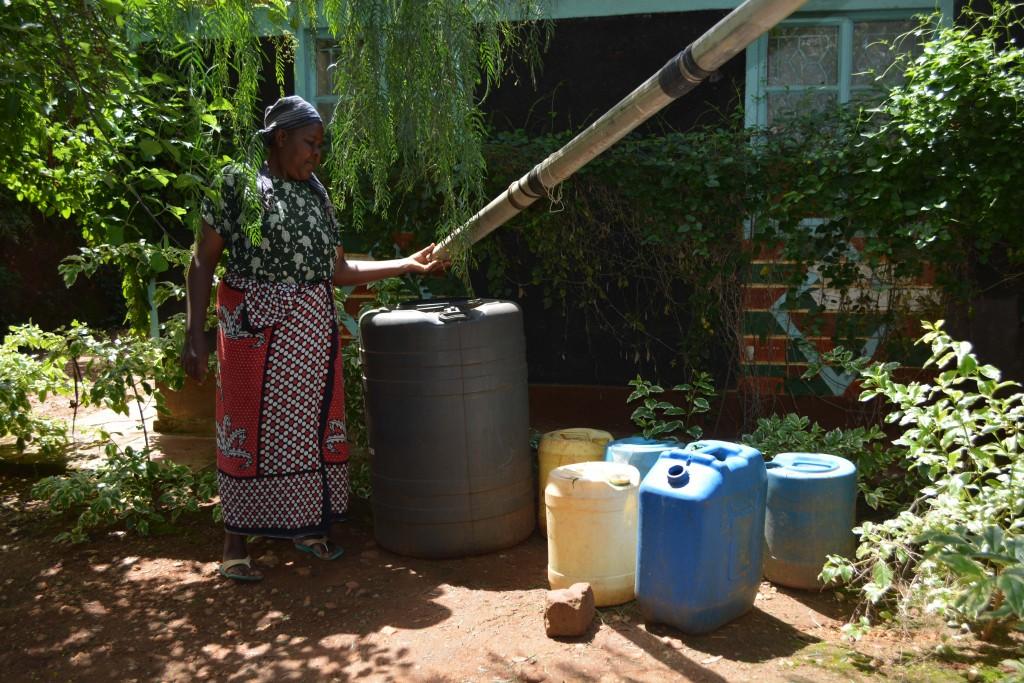 The Water Project : 9-kenya4770-catching-rainwater