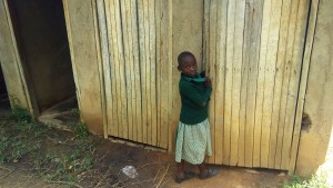 The Water Project:  Little Girl In Front Of Latrines
