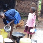 The Water Project: Ebuhando Community -  Alice And Little Sister Washing Utensils