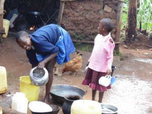 The Water Project:  Alice And Little Sister Washing Utensils